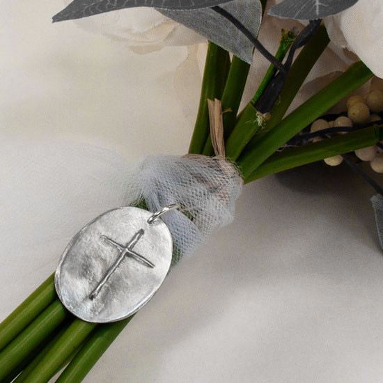 Custom handwritten note on bouquet charm with cross