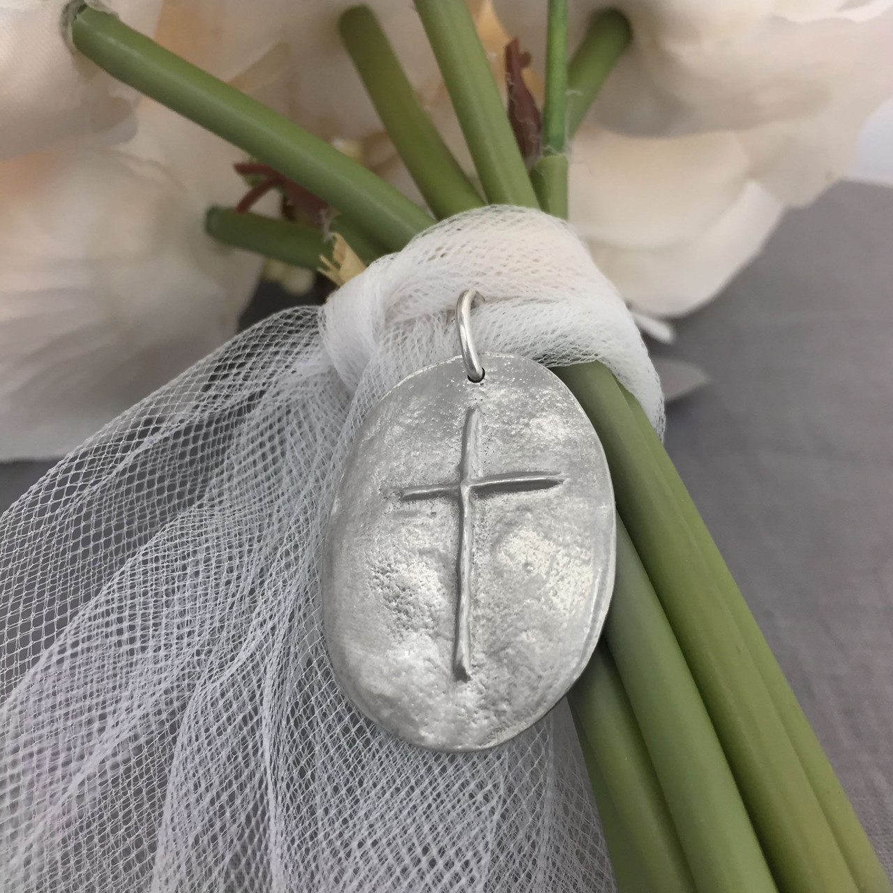 Memorial handwritten note on bouquet charm with cross