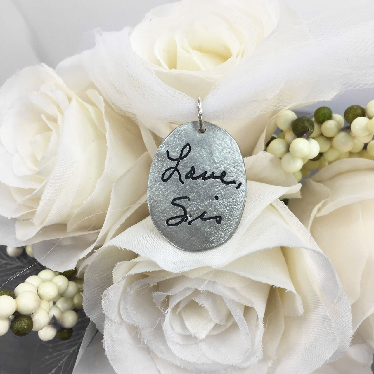 Personalized handwritten note on bouquet charm with cross