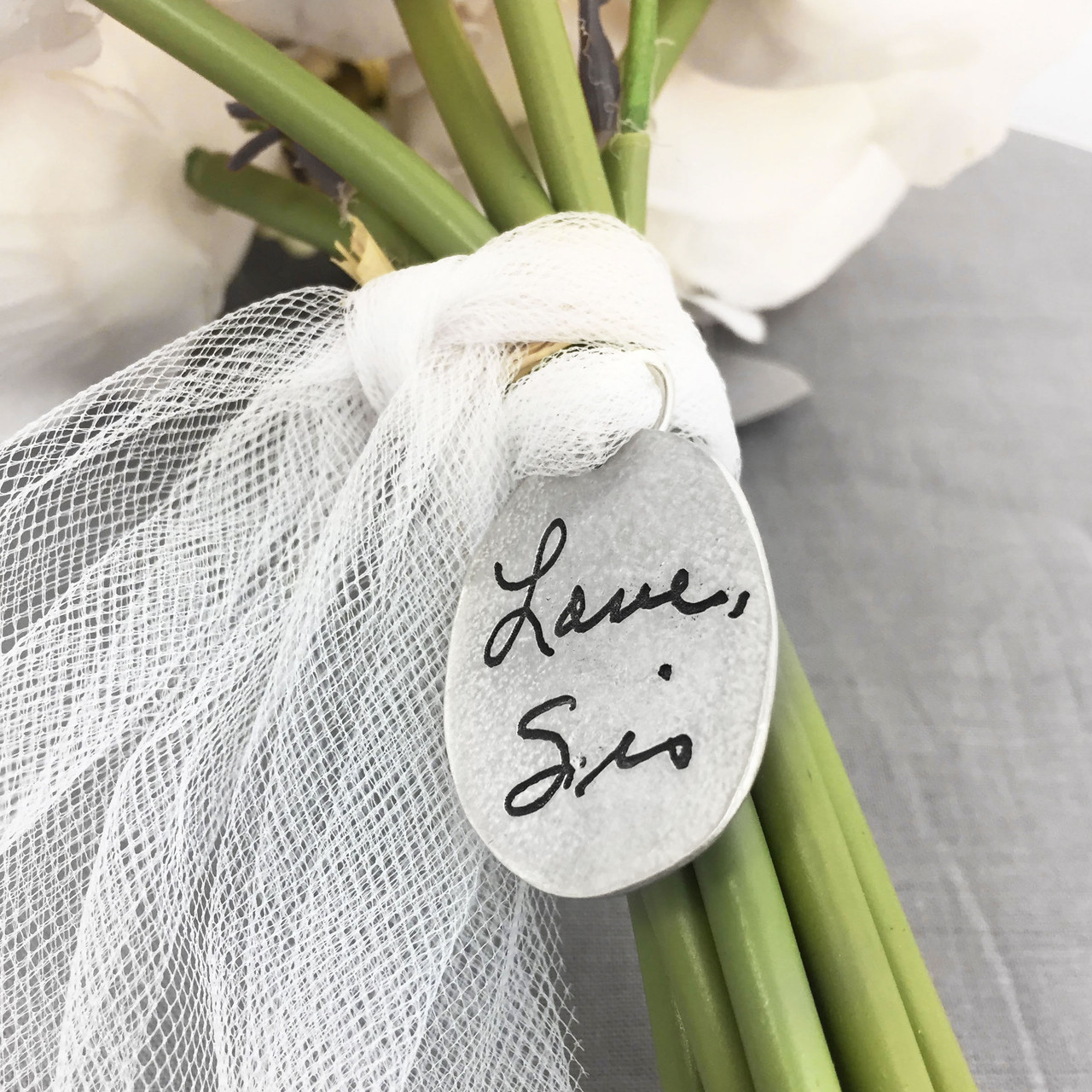 Signature on bouquet charm with cross