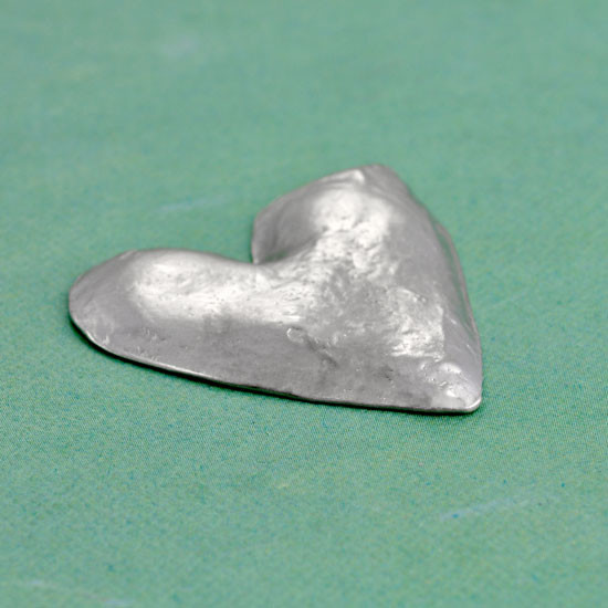 Fine pewter heart pocket token side view