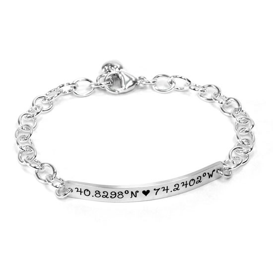 Silver personalized hand stamped coordinates bracelet, with custom location, shown on white