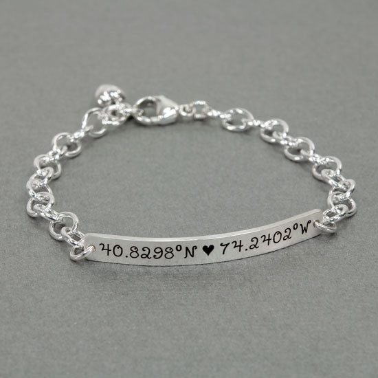 Silver personalized hand stamped coordinates bracelet, with latitude and longitude, shown on white