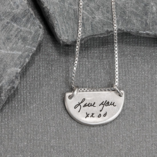 Actual handwriting on custom silver half circle pendant necklace, shown on gray