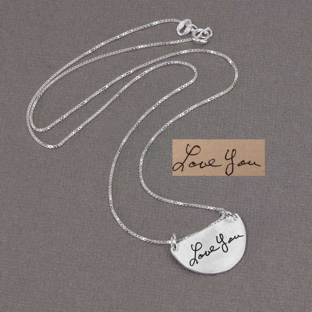 Actual handwriting on custom silver half circle pendant necklace, shown with original handwritten note, on gray
