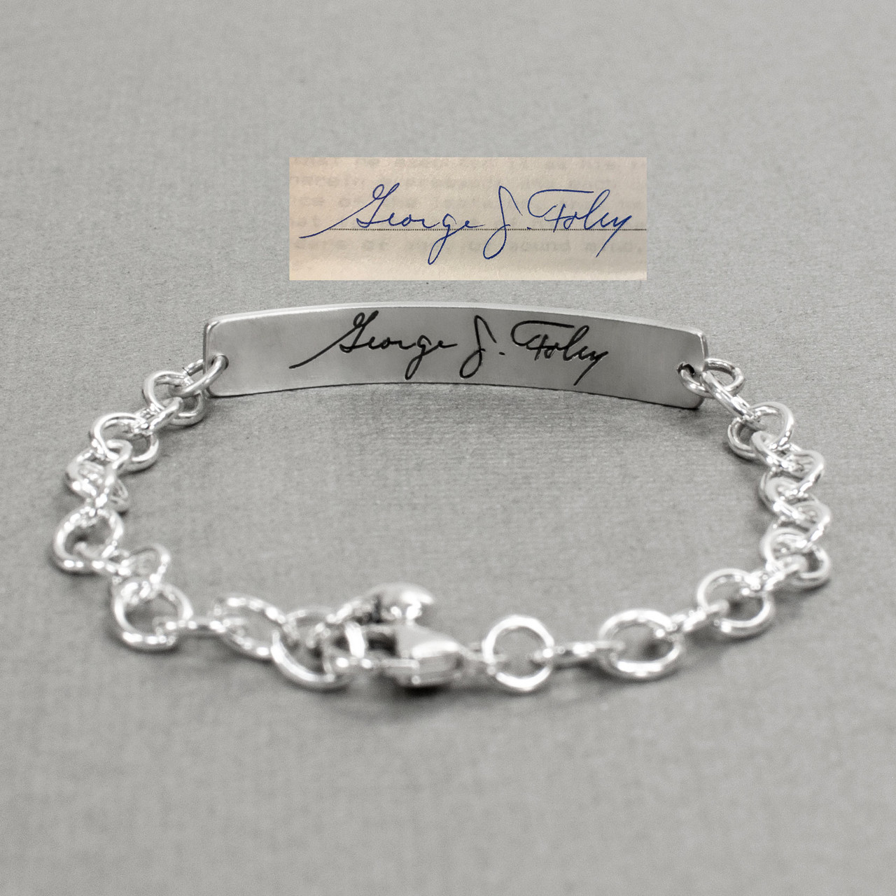 Custom Silver Fingerprint and handwriting ID Bracelet, shown from the back with original handwriting