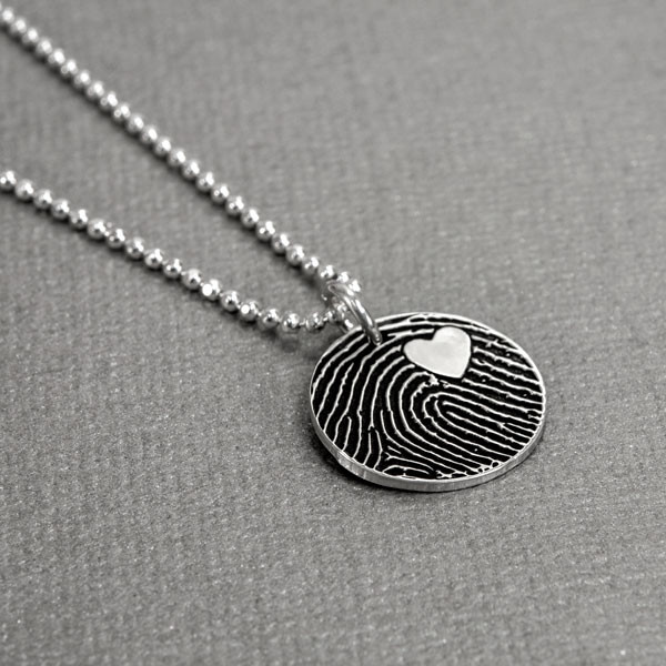 Custom Silver fingerprint necklace, shown from the side