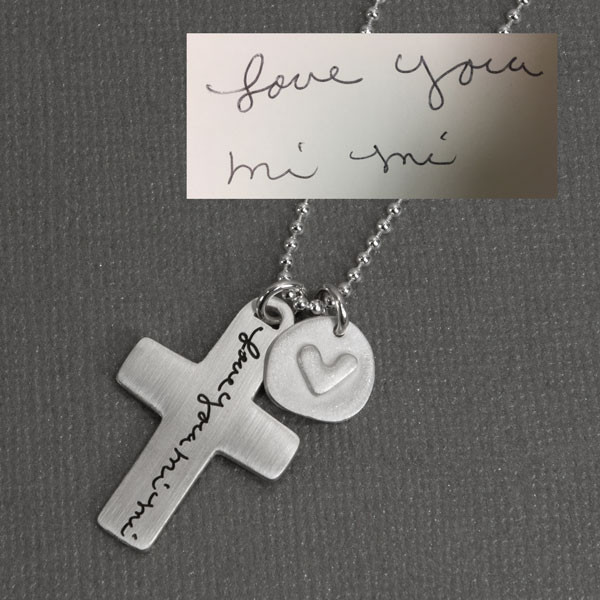 Custom Handwriting Cross Necklace, with handwritten note Love You Mi Mi, shown from top  close up, with original handwriting