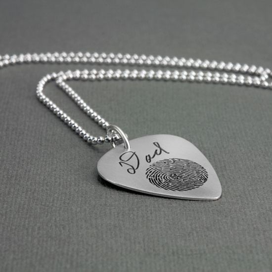 Custom actual fingerprint on guitar pick necklace sterling silver, shown from the side