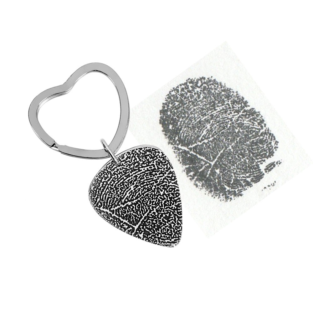 Custom actual fingerprint on guitar pick necklace sterling silver, shown with original fingerprint, with entire charm used for the print