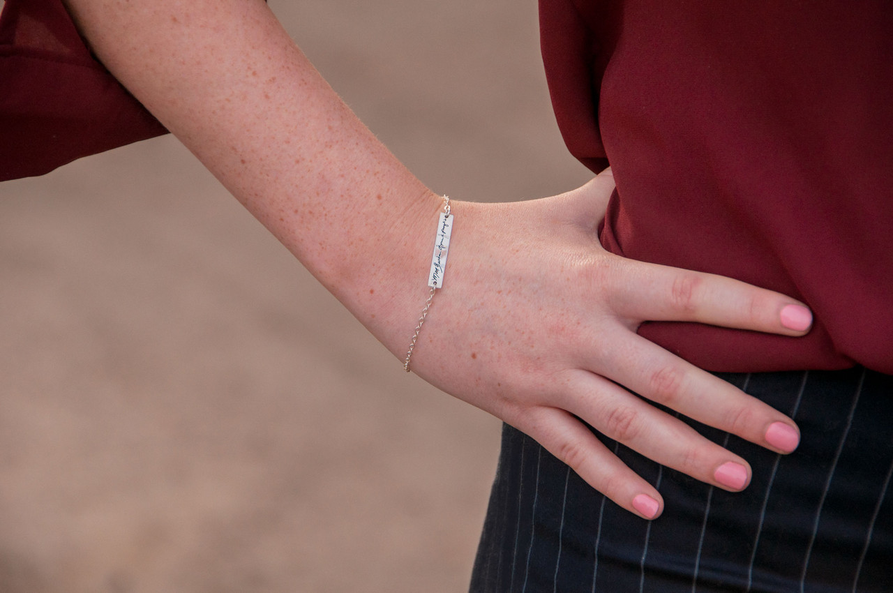 Dainty bracelet with your actual writing in sterling silver, shown on a model
