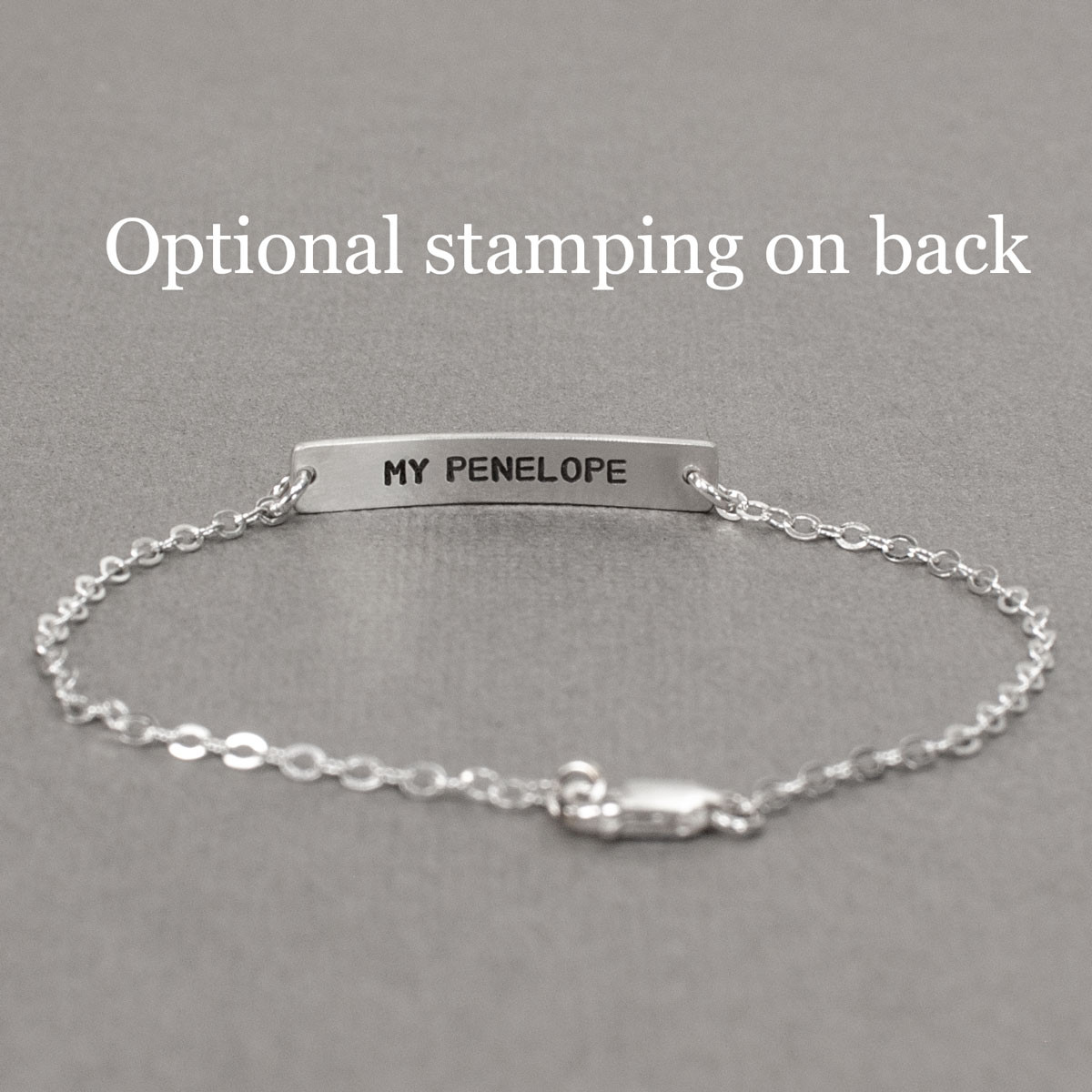 Dainty bracelet with your actual writing in sterling silver, shown with stamping on the back