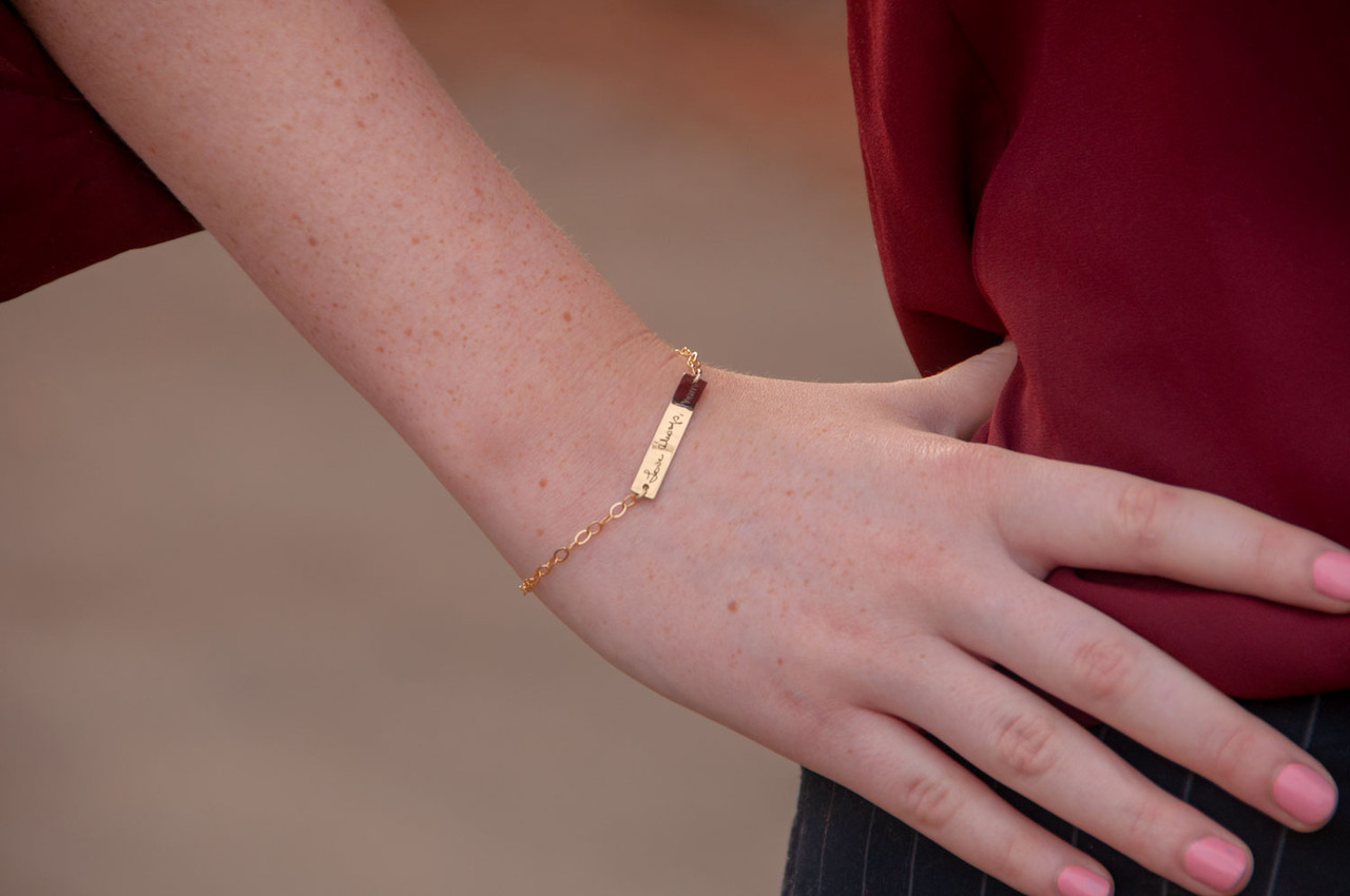 Dainty bracelet with your actual writing in gold, shown on a model