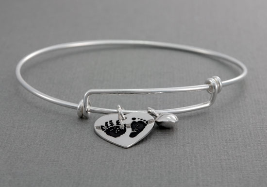 Expandable bracelet with custom handprint or footprint charms