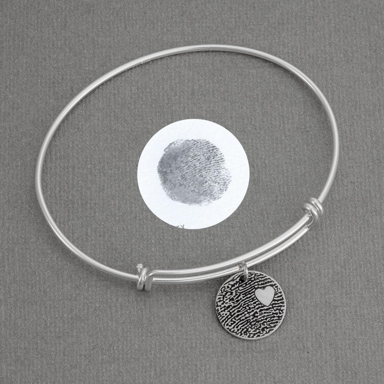 Expandable sterling silver bracelet with custom fingerprint pendant, shown with original fingerprint