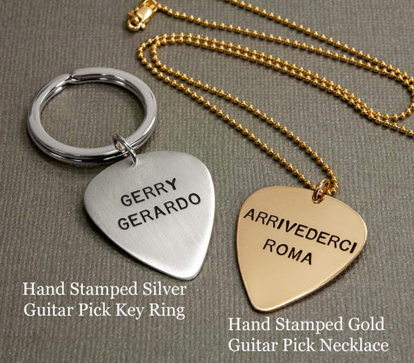 Sterling silver hand stamped guitar pick key chain shown with Gold hand stamped guitar pick necklace