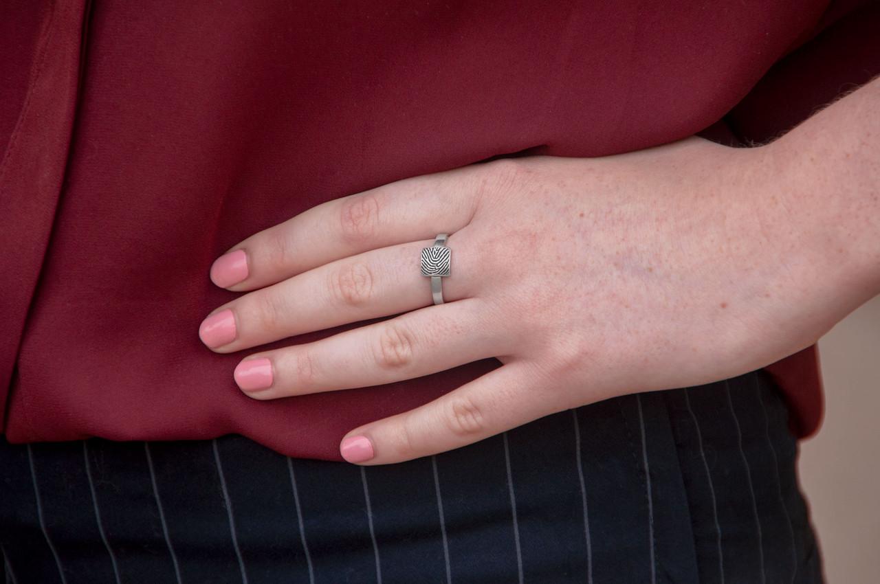 custom square shaped fingerprint jewelry ring in sterling silver, shown on model