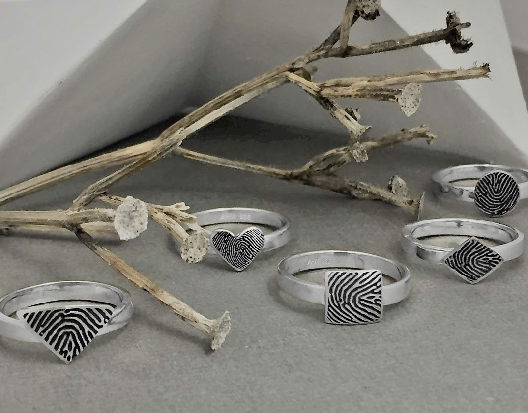Collection of silver rings made with your actual fingerprints