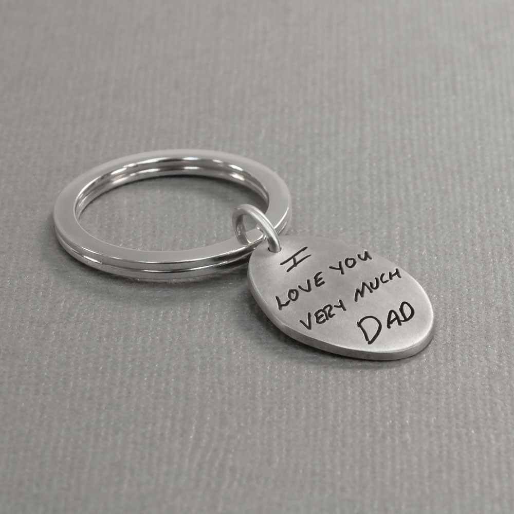 Silver oval handwriting signature key ring with your actual handwriting, shown from side