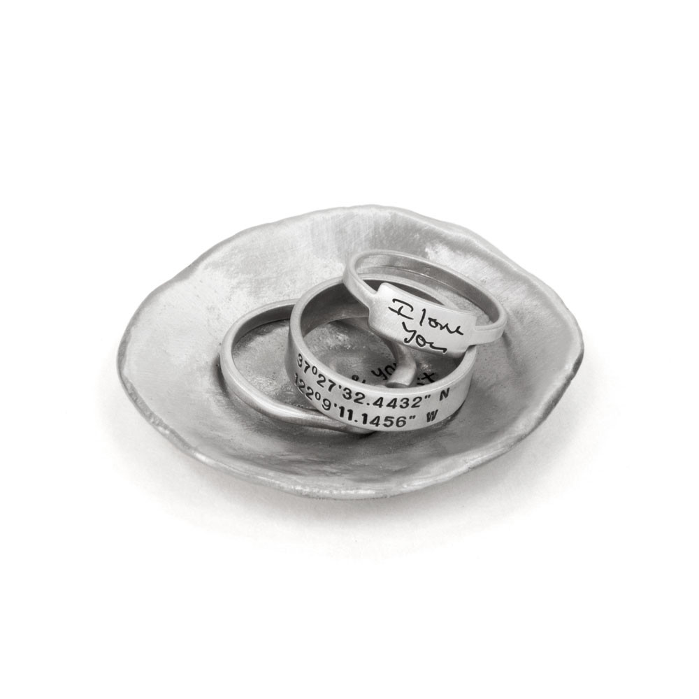 Personalized handmade pewter jewelry dish, shown with jewelry in it