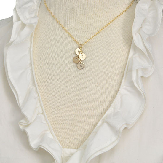 Gold cascading initial necklace