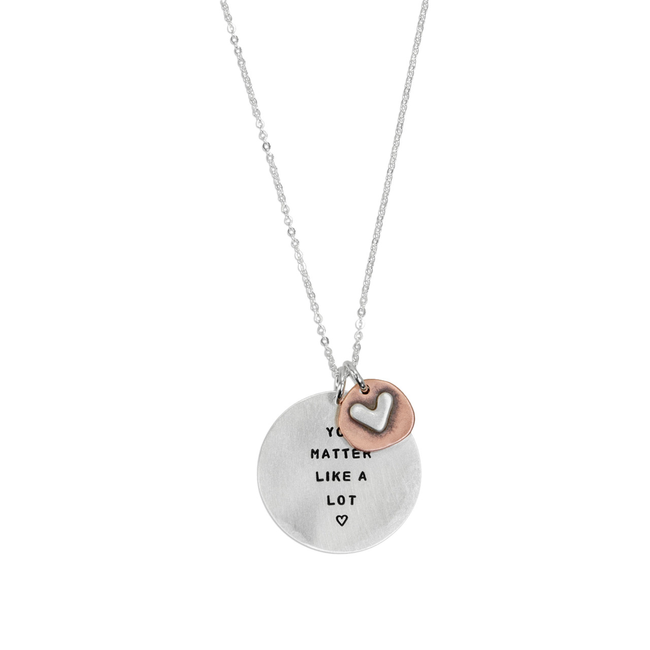 Memorial silver hand stamped necklace shown on white, with a copper and silver heart