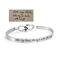 Sterling silver handwriting cuff bracelet with clasp, shown with the handwriting used to create it