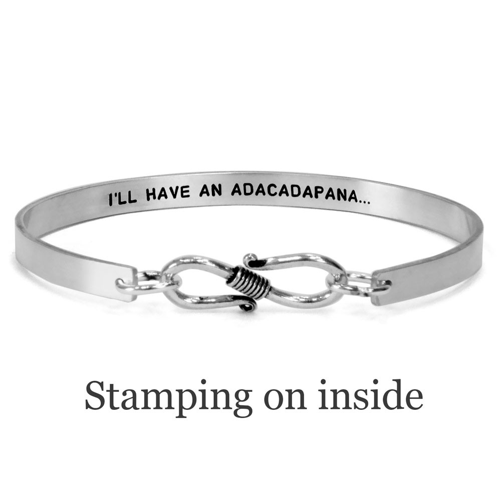 Sterling silver handwriting cuff bracelet with clasp, shown from the back on white, with optional stamping inside