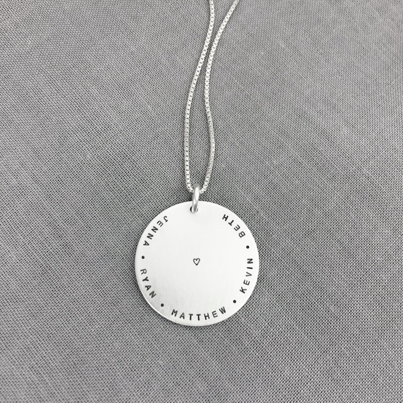 Stamped pendant with family names and heart