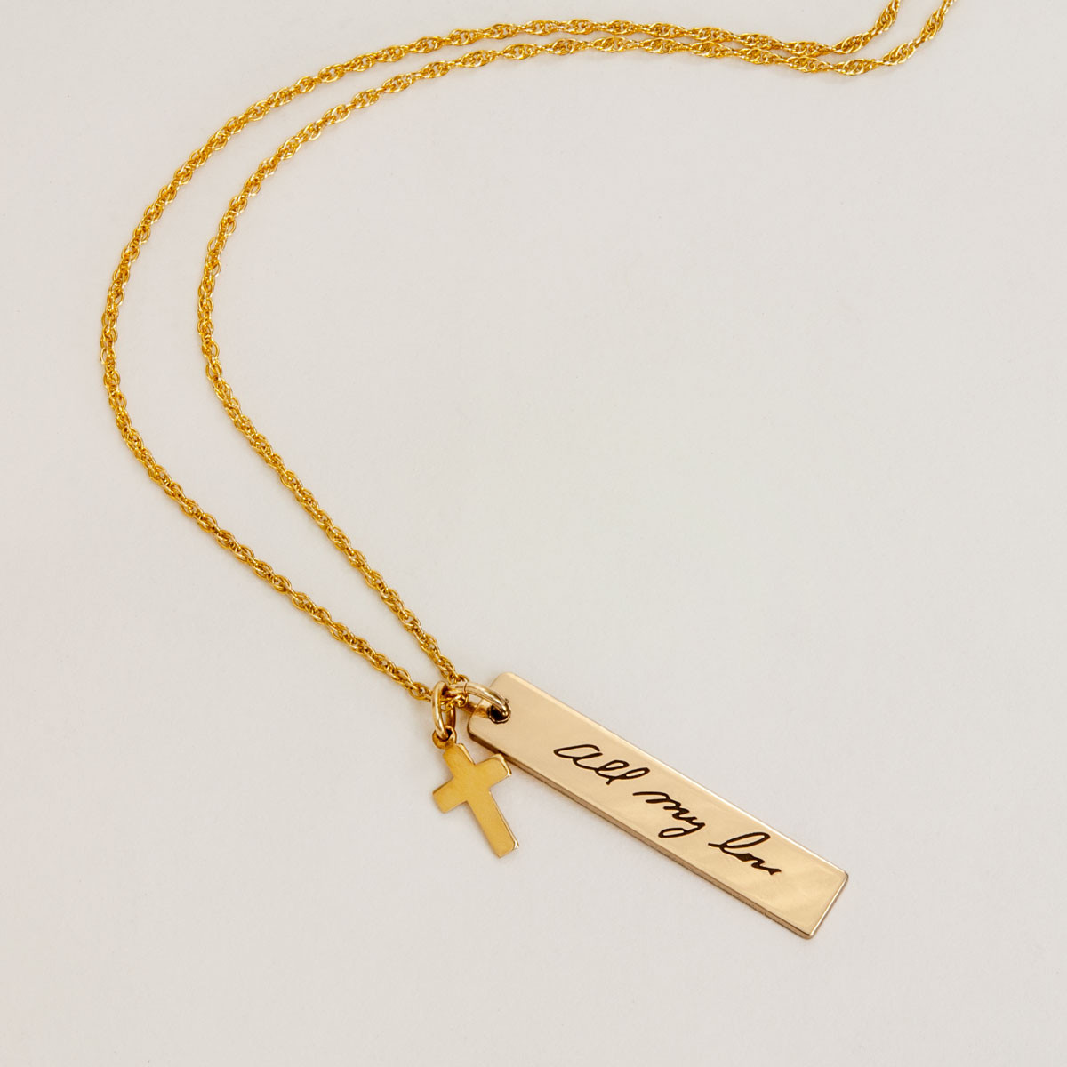 Gold handwriting name tag with gold cross