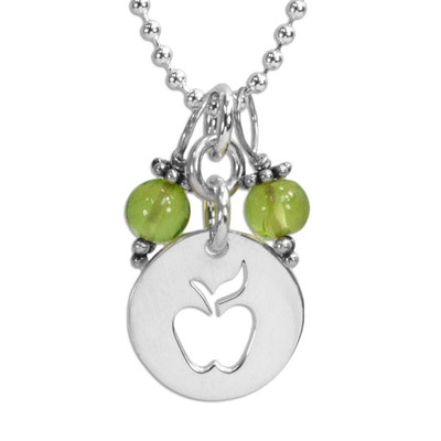 Apple & Peridot Necklace with silver apple teacher gift, close up on white