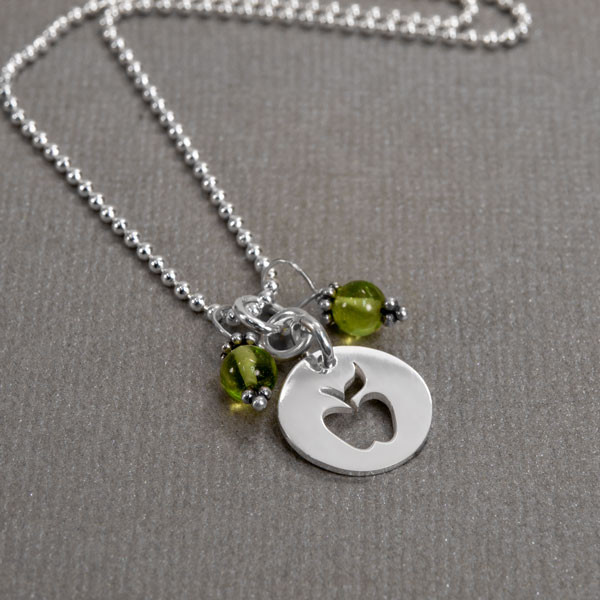 Apple & Peridot Necklace with silver apple teacher gift, shown from the side