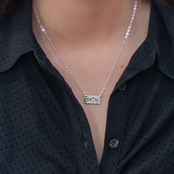 Sterling silver handmade Birds in Love Necklace on a model