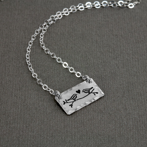 Sterling silver handmade Birds in Love Necklace side view on gray