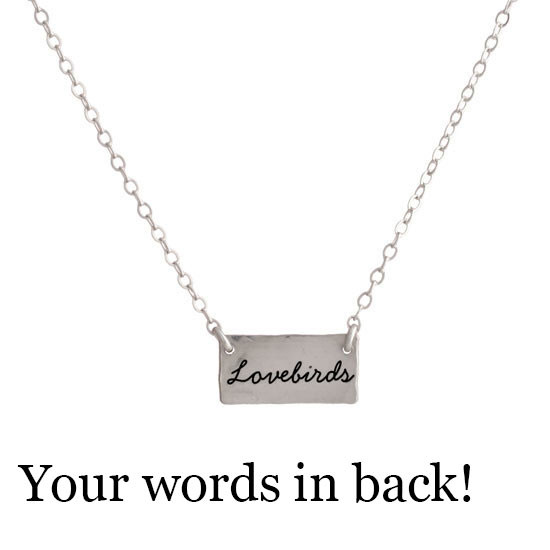 Sterling silver handmade Birds in Love Necklace on white wider view showing personalized back