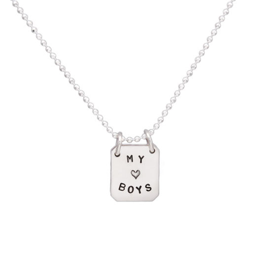 Book Of Love silver hand stamped personalized necklace, shown from the front on white
