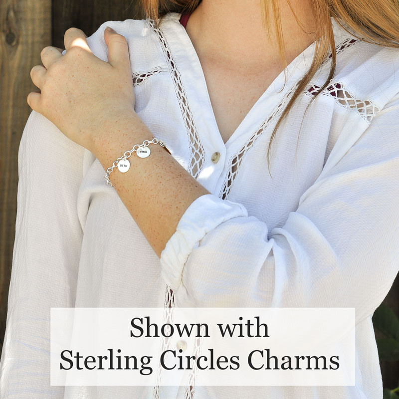 Sterling Silver Charm Bracelet Chain, with puffed silver heart, shown on model with silver circle charms stamped with kids' names
