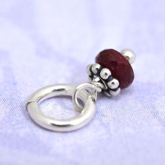 Close up of birthstone, shown from side