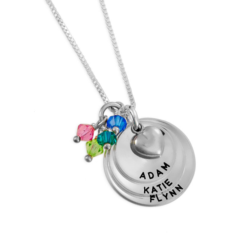 Custom sterling silver curved discs necklace, personalized with hand stamped kids names and birthstones, shown close up on white