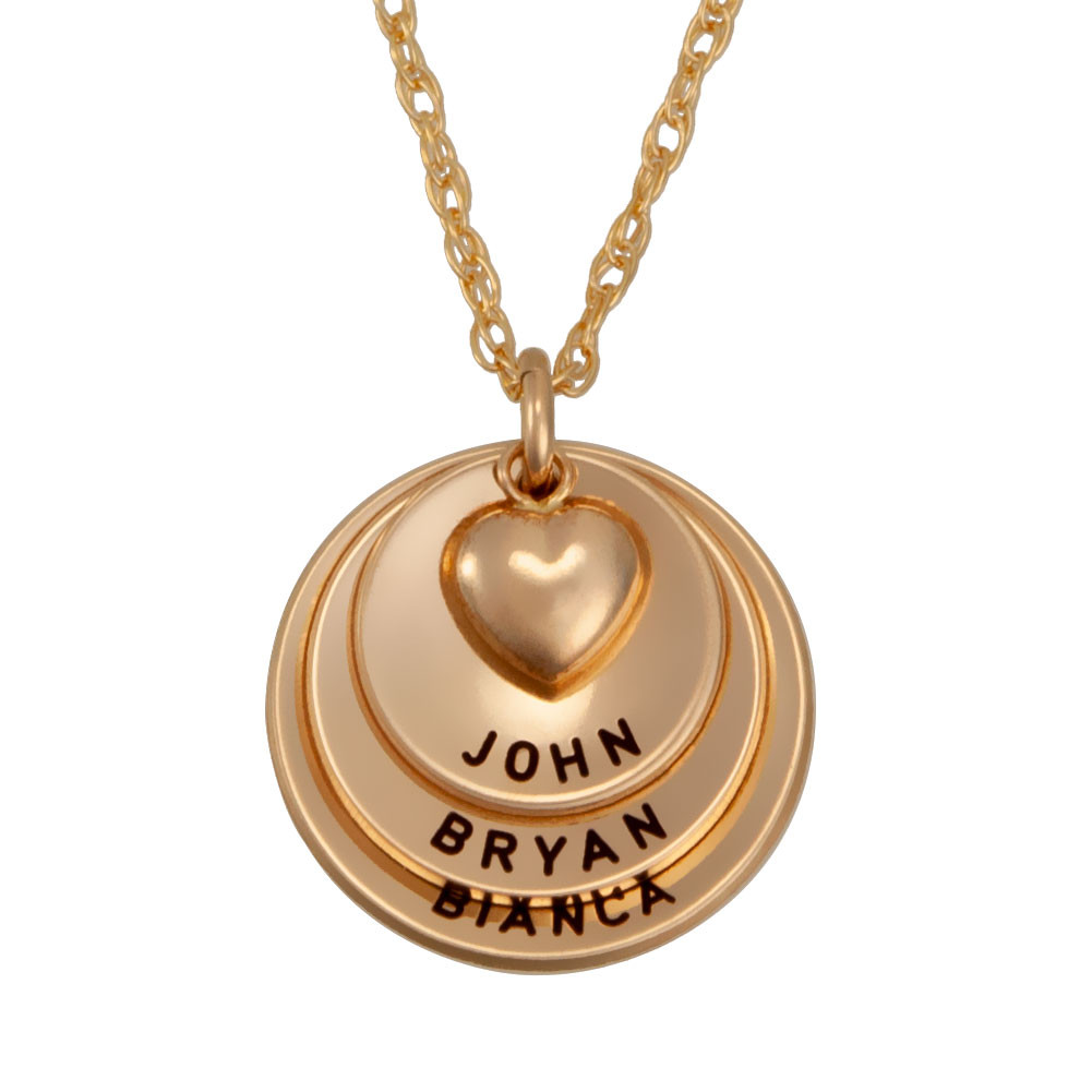Gold curved discs with heart, stamped with names, shown close up on white
