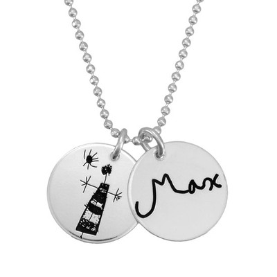 Custom silver handwriting jewelry charms with child's signature and drawing, shown close up on white