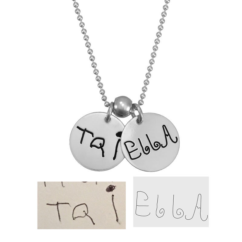 Custom silver handwriting jewelry charms with children's signatures, shown with the original handwritten notes used to create them