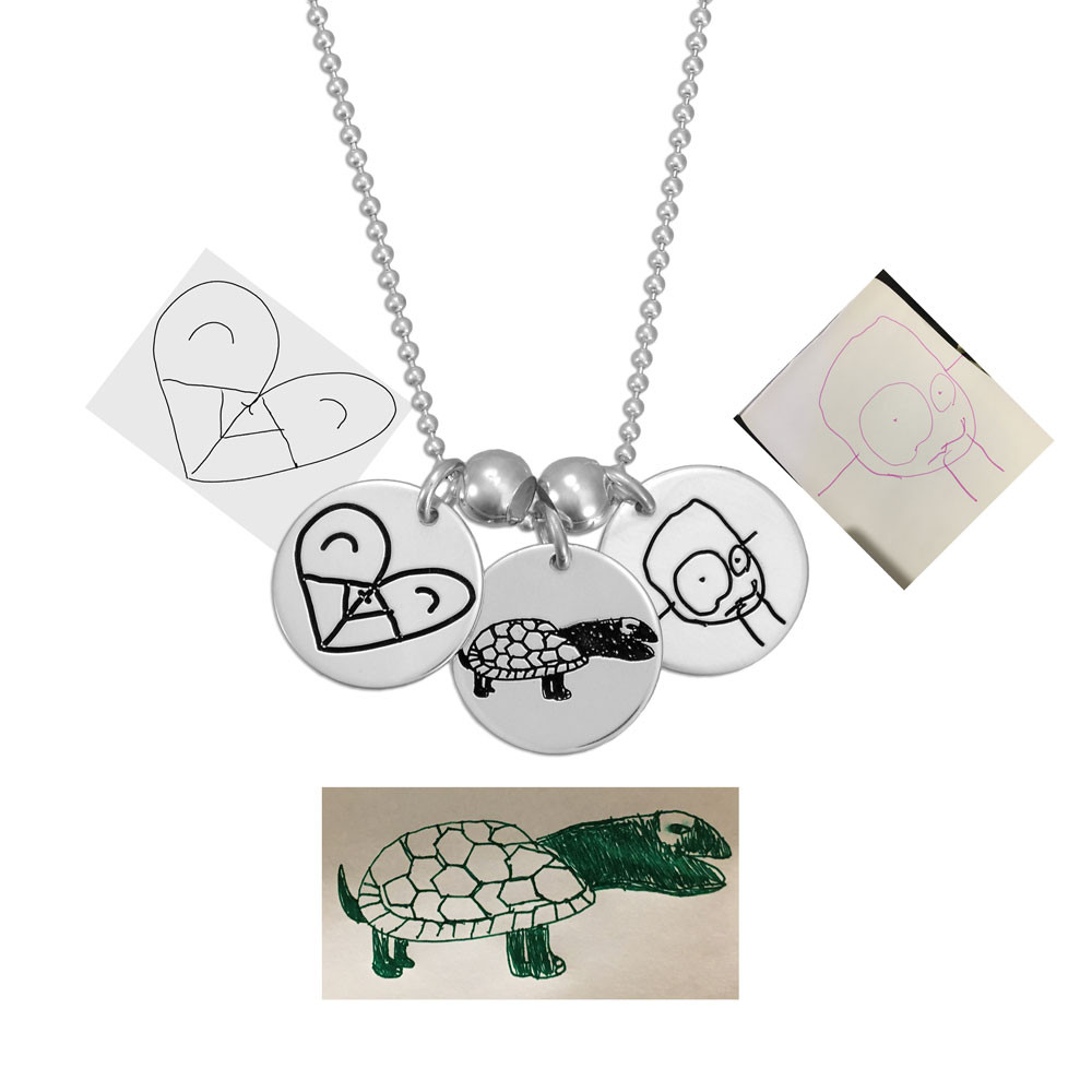 Custom Silver Handwriting Jewelry Charms with child's original artwork, shown with the artwork used to create it