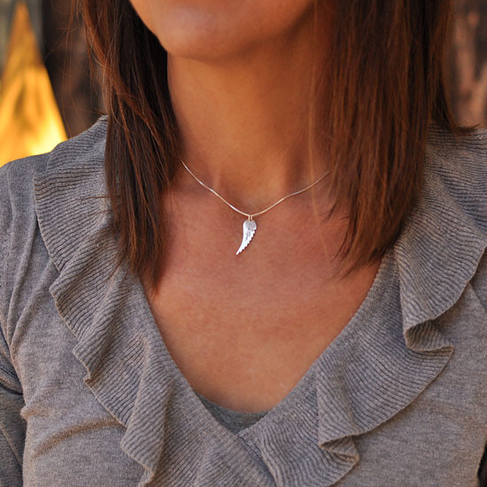 Custom Handwriting Memorial Charm Angel Wing Necklace, shown on a model