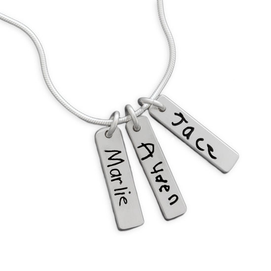 Signature necklace in sterling silver, with three children's actual handwriting, shown close up on white background