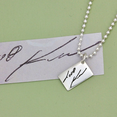 Love Note showing original writing and necklace created from the writing