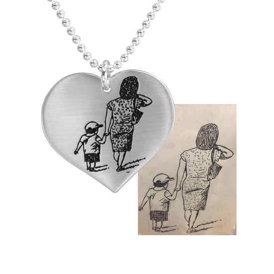 Handwritten drawing on silver necklace