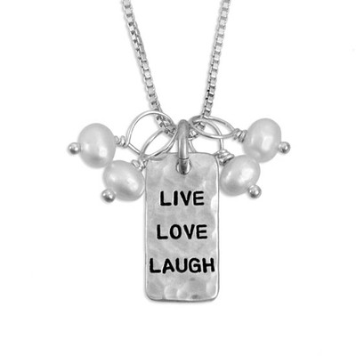 "Silver charm hand stamped, ""Live Love Laugh"", hammered to add texture, with pearls on silver chain, shown close up"
