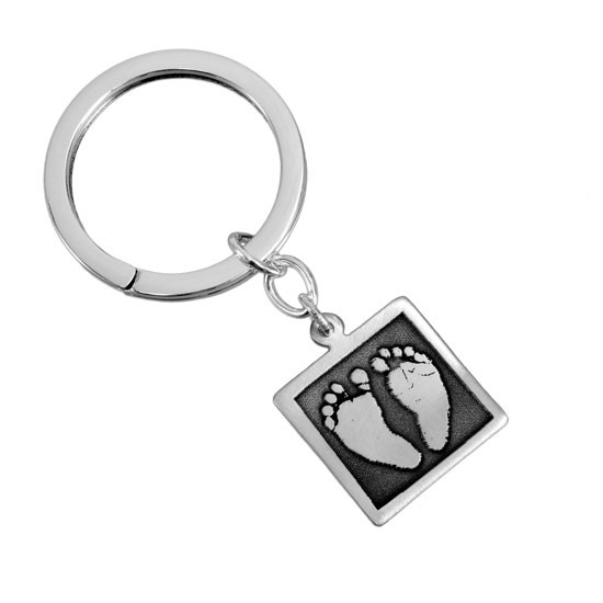 Your child's footprints on a sterling silver key chain