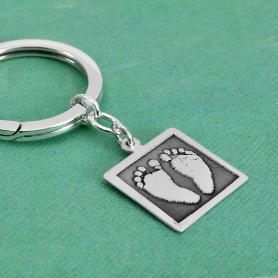 Your kid's footprints on a sterling silver key ring